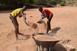 The Water Project:  Scooping Sand