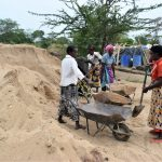 The Water Project: Kaukuswi Community A -  Hauling Sand