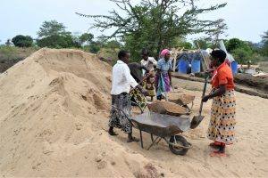 The Water Project:  Hauling Sand