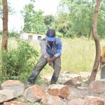 The Water Project: Kyamatula Secondary School -  Breaking Large Rocks