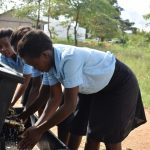 The Water Project: Kyamatula Secondary School -  Girls Using Handwashing Station