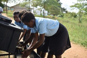 The Water Project:  Girls Using Handwashing Station