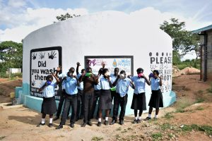 The Water Project:  Students Drink Water From The Tank