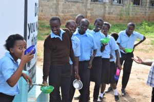 The Water Project:  Students Lined Up To Get Water From The Tank