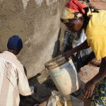 The Water Project: Kamulalani Primary School -  Helping Cure The Cement