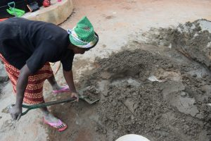 The Water Project:  Scooping Cement