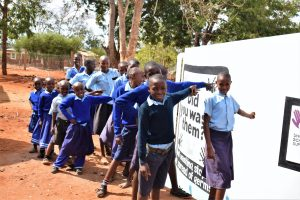 The Water Project:  Students Point To The New Tank