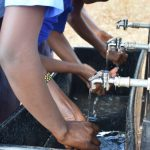 The Water Project: Kamulalani Primary School -  Using The New Washing Station