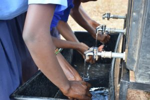 The Water Project:  Using The New Washing Station