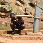 The Water Project: Maluvyu Community D -  Drinking Water From The Well