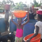 The Water Project: 45 Main Motor Road, The Redeemed Christian Church of God -  Community Members Fetch Water For Drilling
