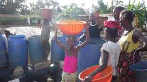 The Water Project:  Community Members Fetch Water For Drilling