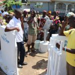 The Water Project: 45 Main Motor Road, The Redeemed Christian Church of God -  The Church Pastor Dedicating The Well