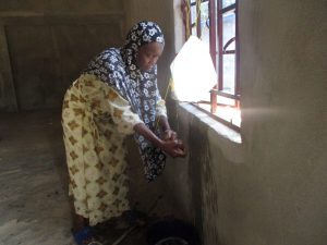 The Water Project:  Woman Demonstrates The Tippy Tap