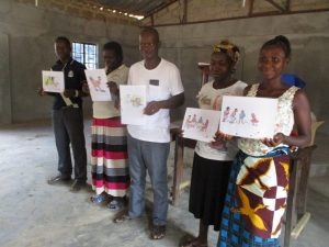 The Water Project:  Community Members Are Shown Displaying Disease Transmission Story Posters