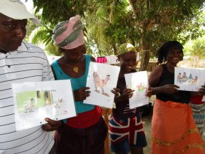 The Water Project:  Adults Holding Training Posters