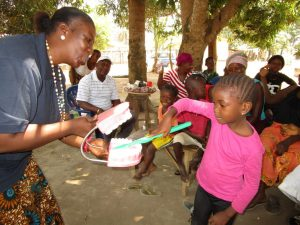 The Water Project:  Young Girl Demonstrates Toothbrushing