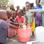 The Water Project: Targrin Health Post -  Community Children Playing With Clean Water