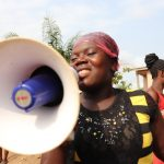 The Water Project: Targrin Health Post -  Community Member Leading A Song
