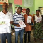 The Water Project: Targrin Health Post -  Community Members Hold Disease Transmission Posters