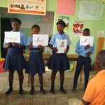 The Water Project: Targrin Health Post -  Students Hold Posters