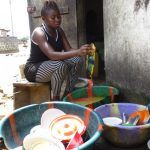 The Water Project: Lungi, Masoila, #3 Kamara Street -  Woman Cleaning Dishes