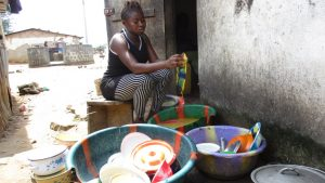 The Water Project:  Woman Cleaning Dishes