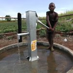The Water Project: Rubana Yagilewo Community -  Child Pumps Well