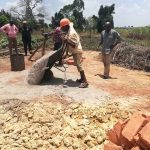 The Water Project: Rubana Yagilewo Community -  Dumping Cement
