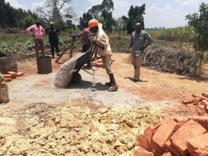 The Water Project:  Dumping Cement