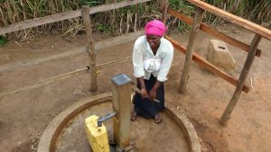 The Water Project:  Kunihira Roselyne Fills Container With Water