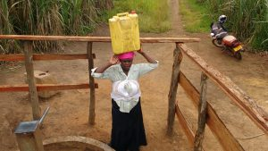 The Water Project:  Kunihira Roselyne Lifts Water Container