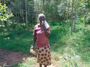 The Water Project:  Village Elder Whistles To Community To Start Mobilizing Materials