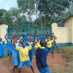 The Water Project: Saride Primary School -  Students In Front Of Schools Gate