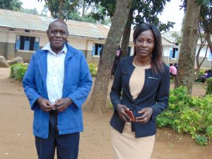 The Water Project:  Head Teacher Mrs Shira Aidah And Mr Wilfed Jideyi