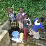 The Water Project: Mungakha Community, Asena Spring -  A Year Later Still Smiling