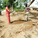 The Water Project: Enyapora Primary School -  Sifting Sand For Construction