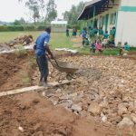 The Water Project: Elufafwa Community School -  Adding Cement To Stone Foundation Of Rain Tank