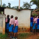 The Water Project: Kapsaoi Primary School -  Boys Lining Up For Latrines