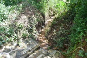 The Water Project:  Good Drainage Channel Kept Cleared