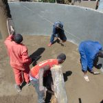 The Water Project: Ematiha Secondary School -  Cementing Tank Floor And Central Support Pillar
