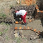 The Water Project: Chegulo Community, Sembeya Spring -  Bricksetting Continues