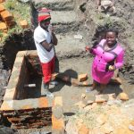 The Water Project: Chegulo Community, Sembeya Spring -  Team Leader Catherine Chepkemoi Inspecting The Work