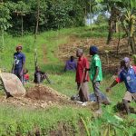The Water Project: Emmachembe Community, Magina Spring -  Community Memners Helping Out