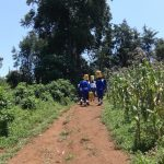 The Water Project: St. Teresa's Isanjiro Girls Secondary School -  Students Carrying Water