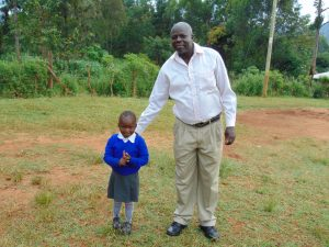 The Water Project:  Head Teacher Mr David Bengat With A Pupil