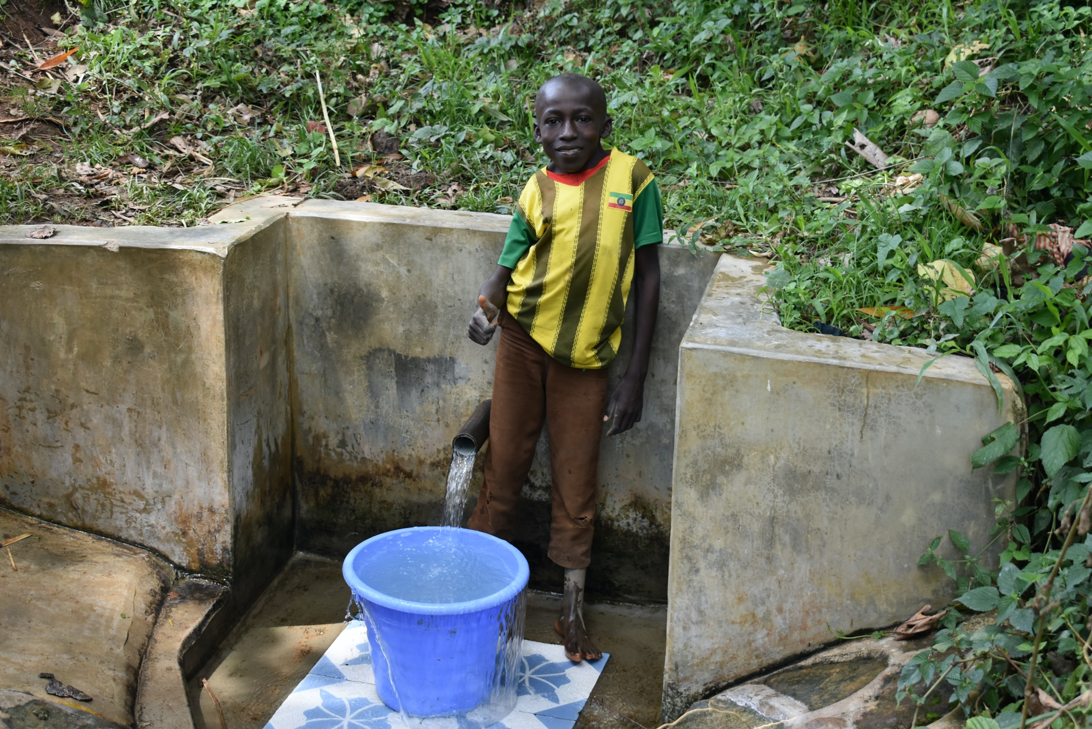 The Water Project : 11-kenya18314-litrelius-gives-a-thumbs-up-at-asena-spring