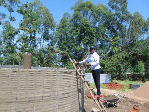 The Water Project:  Field Officer Supervising Work