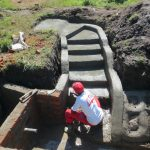 The Water Project: Chegulo Community, Sembeya Spring -  Cementing The Stairs