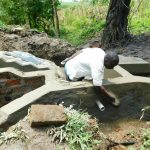 The Water Project: Bung'onye Community, Shilangu Spring -  Plastering Spring Headwall